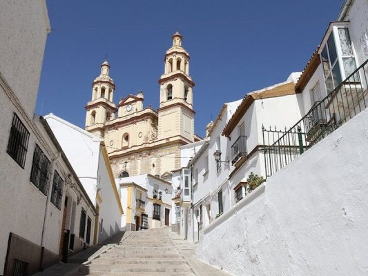 View of Olvera church from the narrow steps up to it.