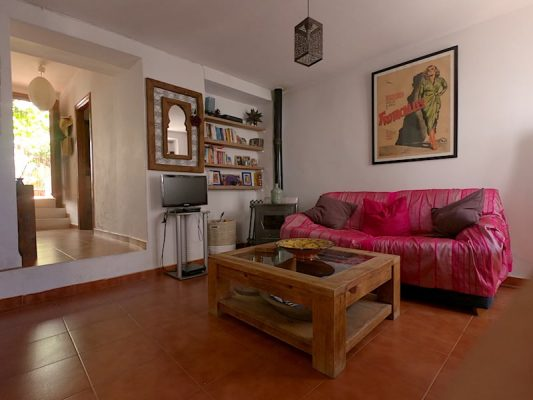 Lounge at Lemon Tree Patio featuring terracotta tiles no terracotta tiles white walls and a sofa bed. Door leading to the terrace